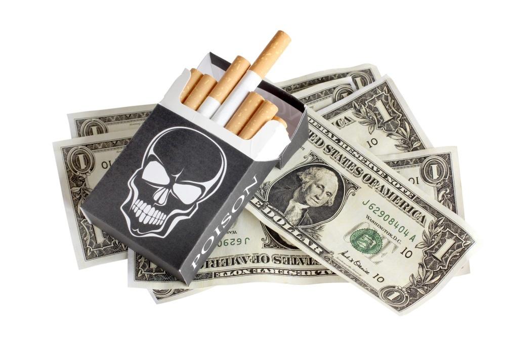Cigarettes box and money