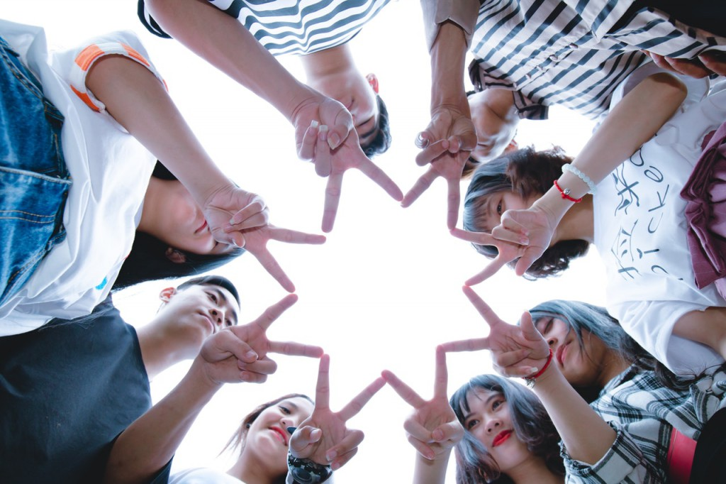 group-of-people-forming-star-using-their-hands-1116302