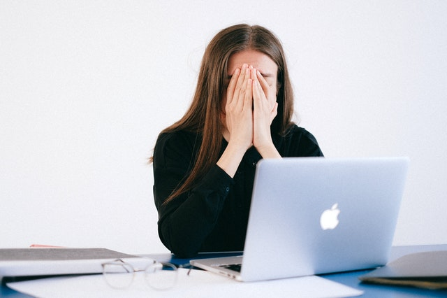woman-with-hands-on-her-face-in-front-of-a-laptop-4226215