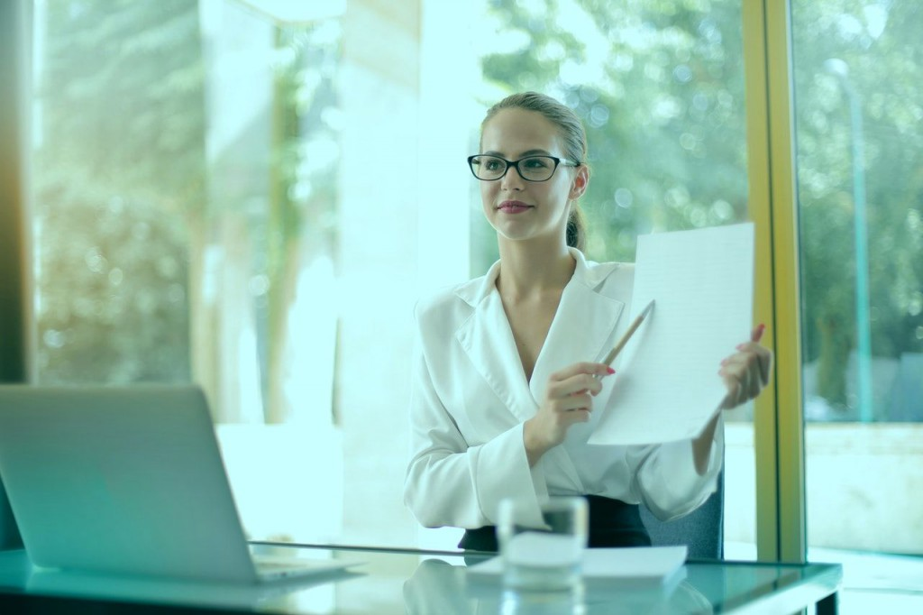 intelligent-businesswoman-explaining-documents-in-office-3757369