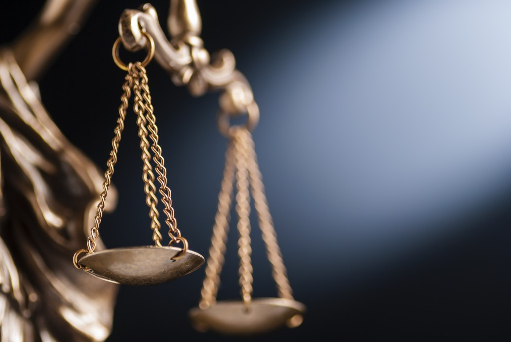 Close up on the scales of justice