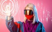 Woman in a face mask and 3D glasses on pink background