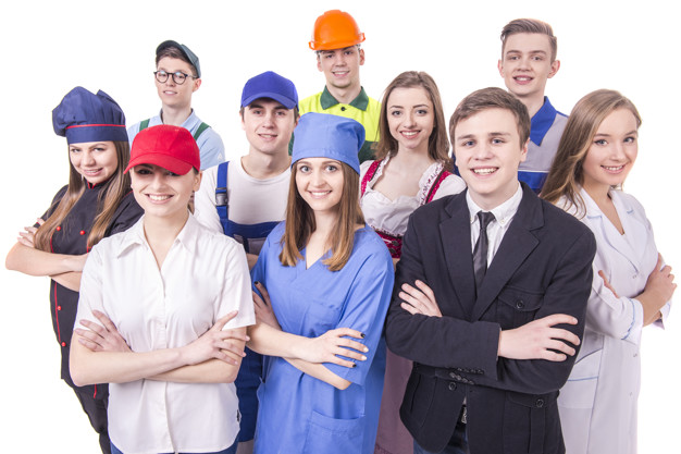 Young group of industrial workers on white background.