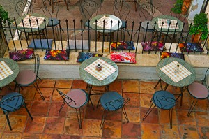 Round tables and chairs in a street cafe