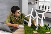 high-angle-man-working-eco-friendly-wind-power-project – копія